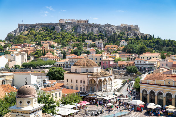 A photo showing the rock of acropolis and the Monastiraki Square in Athens.