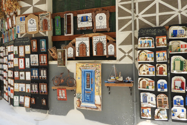 Wall hangings and paintings of a souvenir shop depicting typical doors and windows of Pyrgi village of Chios.