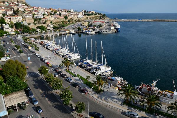 A panoramic view of the port of the city of Kavala including the seafront promenade and a part of the old town.