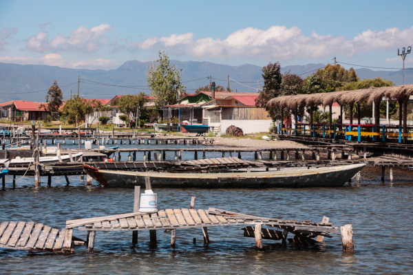 A picture showing wooden bridges, boats and fishermen houses in the Mesolongi Lagoon.