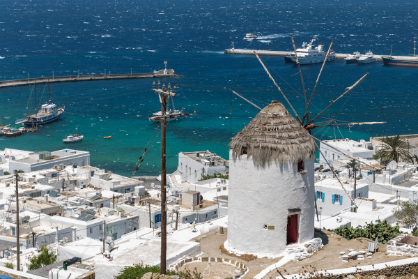 Ancient windmill, overlooking Mykonos' main town (Chora) and its harbour.