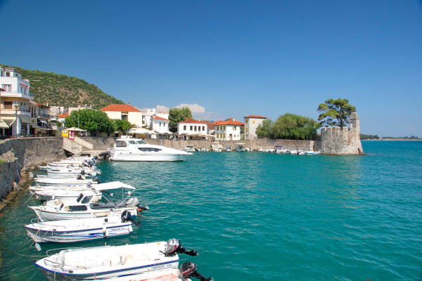 Small boats anchored at the small fortified port of Nafpaktos.
