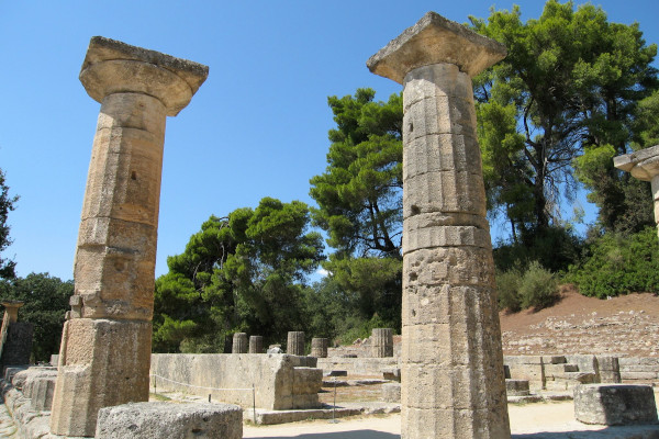 A picture showing two columns and other remains of the archaeological site of Ancient Olympia.