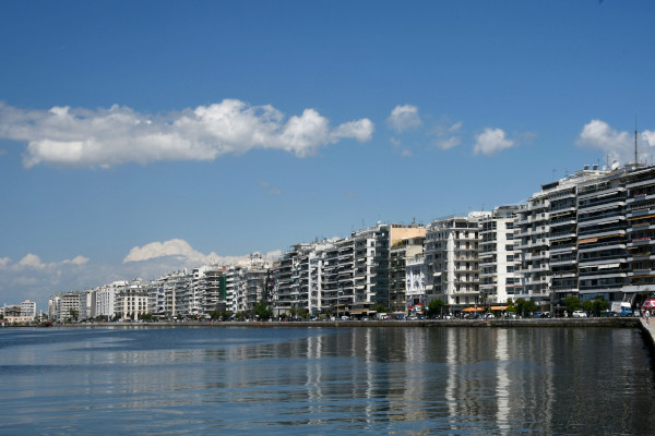 The seafront of the city of Thessaloniki including the high resident buildings and the coastline promenade.