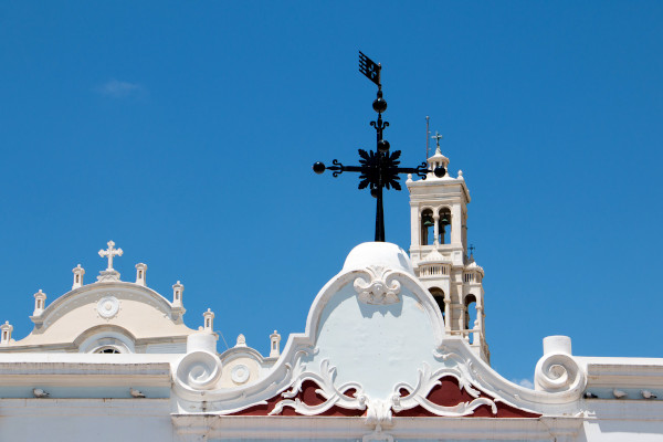 The belfry and a part of the roof of the church of Our Lady of Tinos (Virgin Mary) in the Chora of the island.