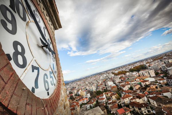 The clock of the Trikala Clock Tower and an overview of the city.