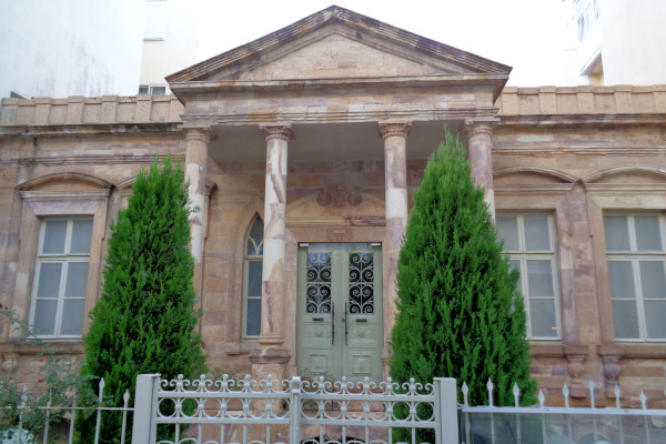 The main entrance of the neoclassical building where the Alexandroupolis Ethnological Museum is housed.