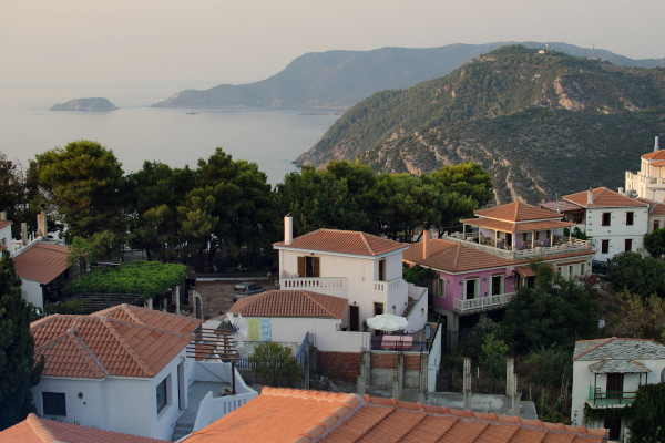 Houses of the Old Village of Alonissos with the beautiful view of the sea and the island coast in the background.