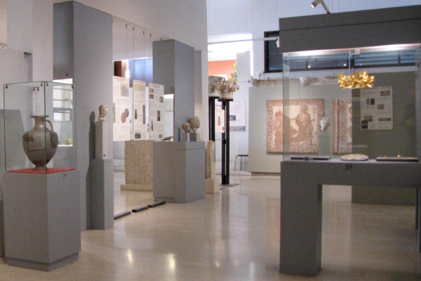 A picture of the interior of one room with displays and exhibits at the Archaeological Museum of Amphipolis.