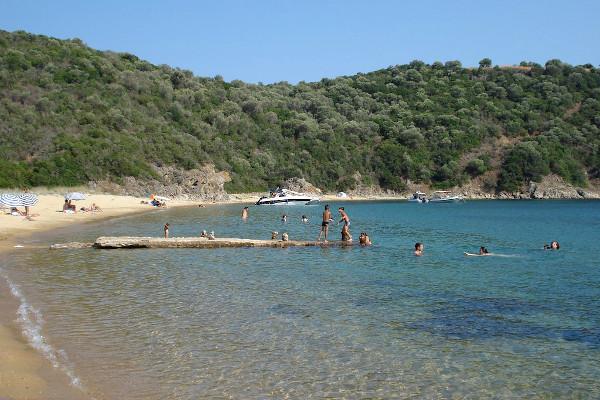 A photo of the old small pier of Karagatsi Beach on Ammouliani island.