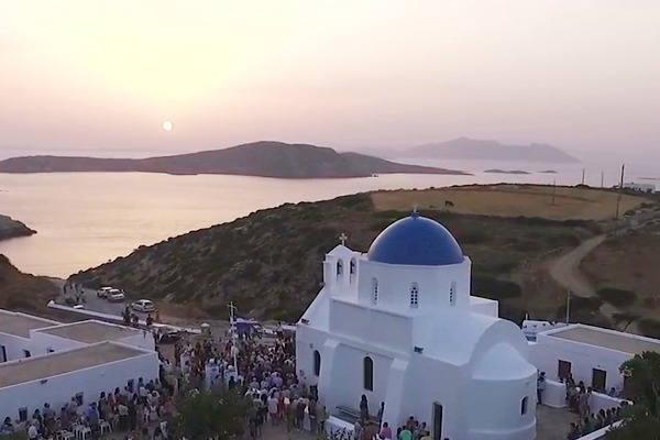 Guests and faithful at the yard of Agia Paraskevi Church in Kato Meria and the sunset in the background.