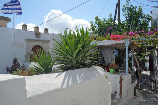A picture from the outside and the outer yard of the Archaeological Museum of Amorgos.