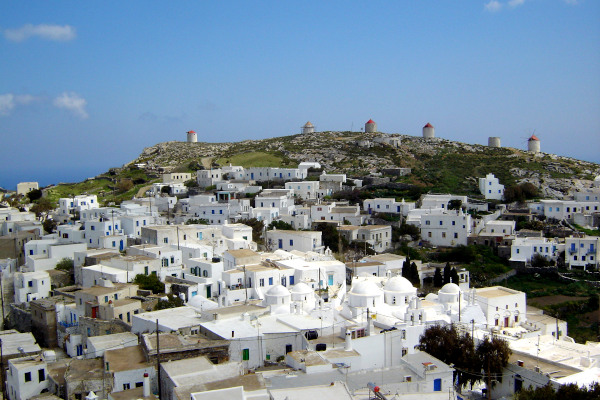 An overview of a part of the settlement of Chora of Amorgos with the windmills in the background.