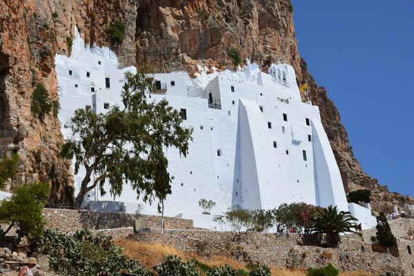 An image of the exterior of the monastery of Panagia Hozoviotissa as it is built on the cliff.
