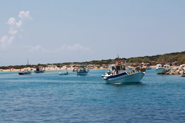 Numerous fishing boats anchored in the windless bay of Kalotaritissa.