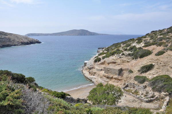 A panoramic photo of the bay that includes the beach of Paradisia at South Amorgos.