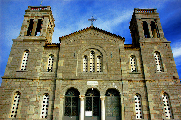 A photo showing the front side and the main entrance of the Church St. George of Arachova.