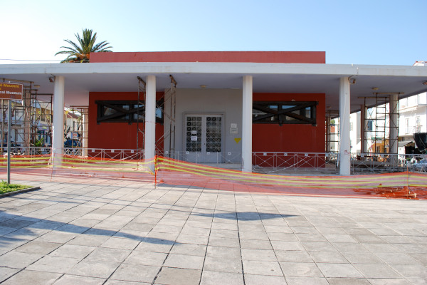 The front side of the Archaeological Museum of Argostoli on Kefalonia enclosed by a protective fence.