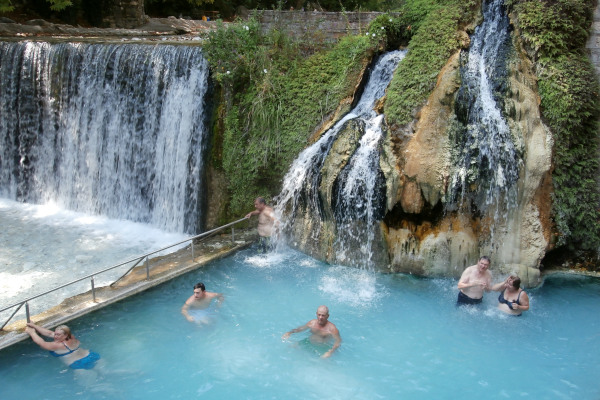 An open-air thermal pool by the river flow at the Pozar area.
