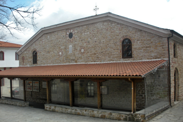 The main entrance and the front entrance of the St. Stefanos church in Arnaia.