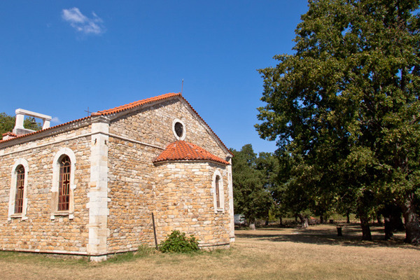 The church of Agia (Saint) Paraskevi surrounded by trees.