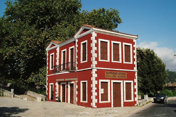 The two-floor red building that hosts the Skoufas Folklore Museum of Arta.