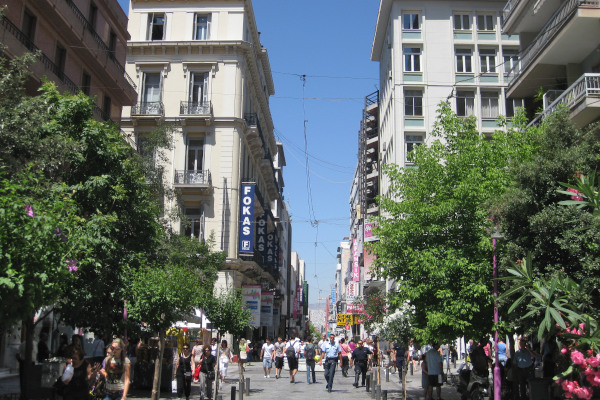 Buildings aligned in the pedestrian shopping street of Ermou in Athens.