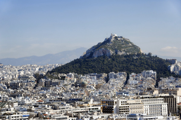 A panoramic view of the hill of Lycabettus among the buildings of the city of Athens.