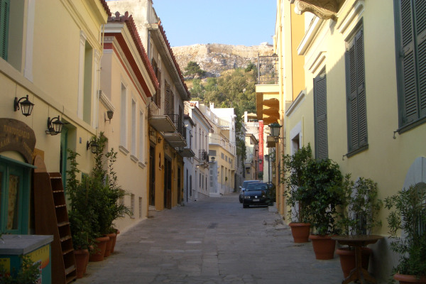 A street with colorful houses in the old traditional district of Plaka in central Athens.