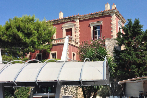 A photo depicting a part of the exterior of the Red House of Maliou Family in Chalkida.