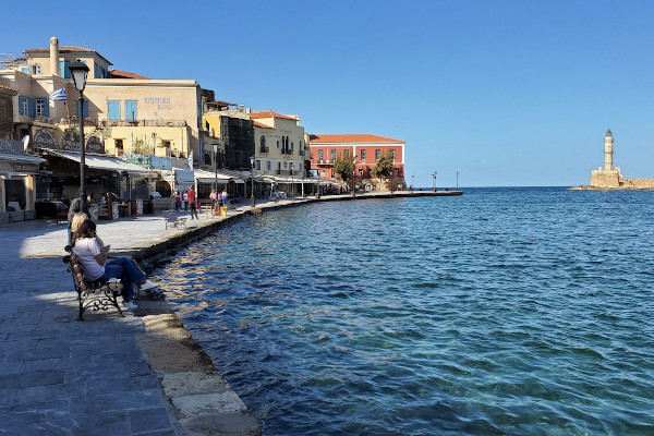 A view of the old port and the promenade by the sea of Chania in Crete.