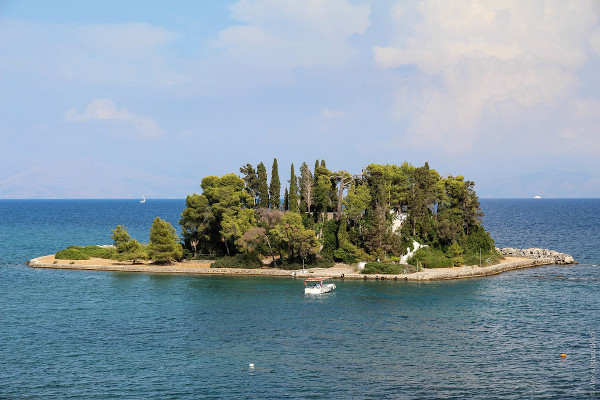 An overview showing the Pontikonisi Islet and its dense vegetation.