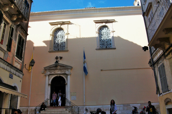The front side of the exterior and the main entrance of the St. Spyridon Church in the old town of Corfu.