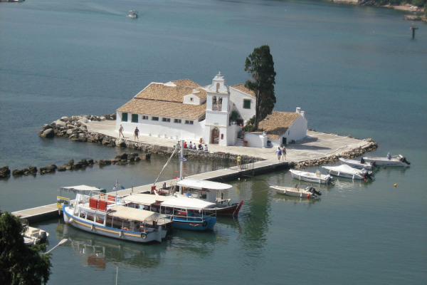 An overview of the Vlacherna Monastery and the narrow pedestrian bridge in Corfu island.