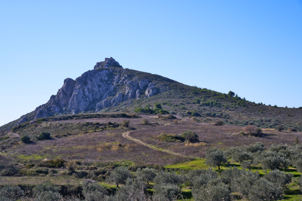 An image showing the rocky hill and the castle of Penteskoufi.