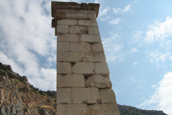 A close up photo depicting the offering Pillar of Prusias II in the Oracle of Delphi.
