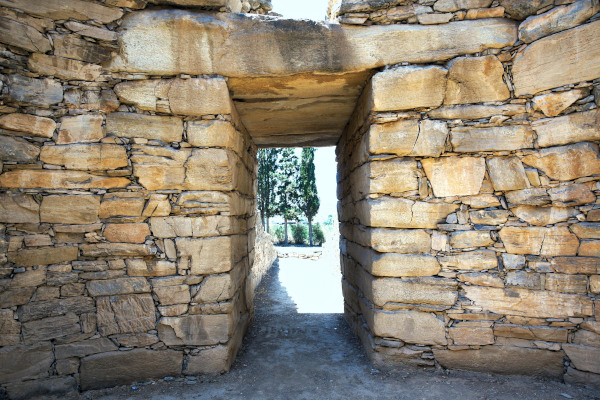 An image showing the main entrance of the Toumpa vaulted tomb at the Neolithic Settlement of Dimini.