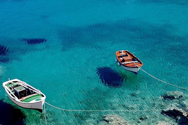 Small fishing boats anchored at the bay of Kalotaritissa on the island of Donousa.
