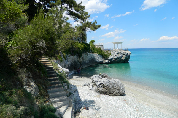 Some steps leading to a part of Platamon beach among the dense vegetation.