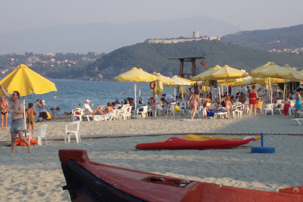 A picture of the beach of Skotina at east Olympos with the Castle of Platamonas in the background.