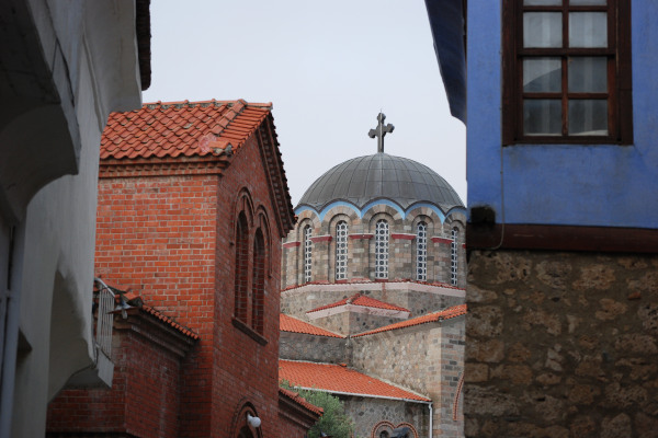 The dome of the church between the buildings of the preserved district of Varosi in Edessa.