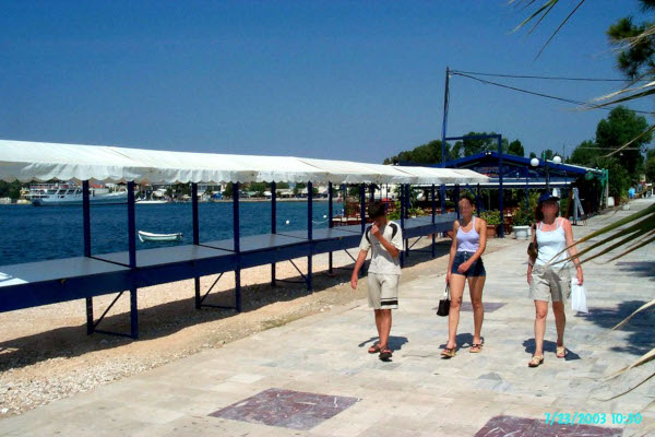 A picture of the paved seafront promenade of Eretria.