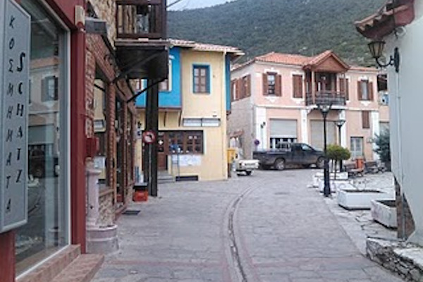 A central street of the village of Galatista with shops and other traditional buildings.