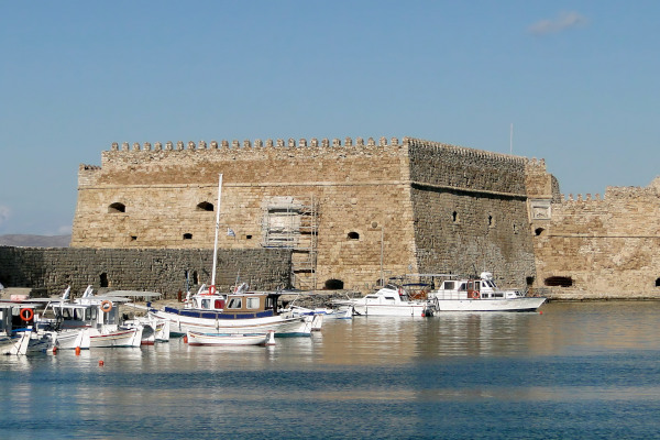 An image showing the exterior of the Venetian Fortress at the port of Heraklion.