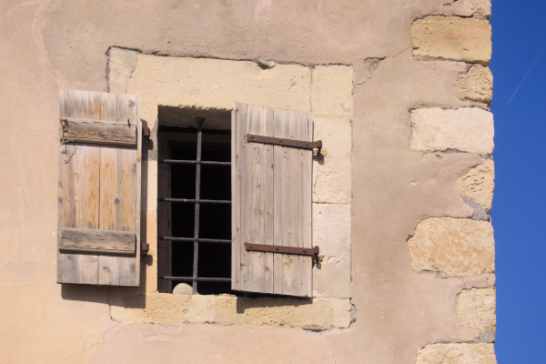A detail of a window and the exterior of the Napoleon's House in Ierapetra.