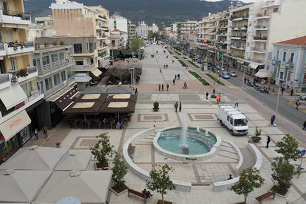 A picture of the Central Square of Kalamata showing an open plaza surrounded by blocks of apartments.