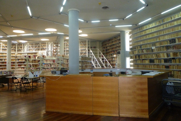 A photo of the interior of the Public Library of Kalamata showing thousands of books on book shelves.