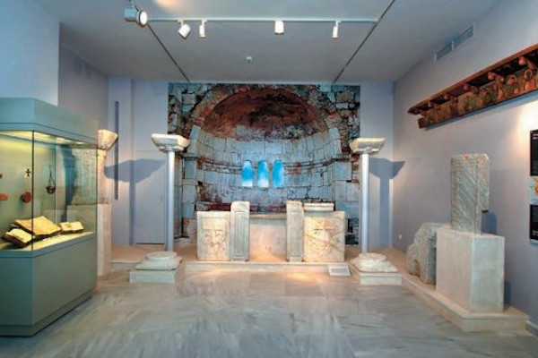 A picture taken inside one of the rooms of the Archaeological Museum of Kalymnos with exhibits and displays.