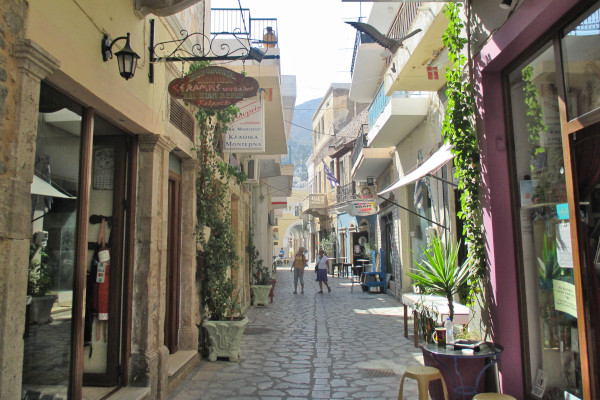 A photo of the central narrow pedestrian road of the Póthia town in Kalymnos.