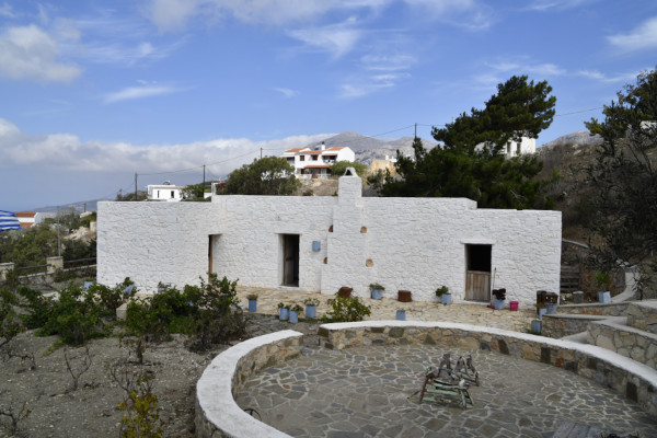 One of the buildings and the threshing floor at the Agricultural Museum of Pyles on the island of Karpathos.